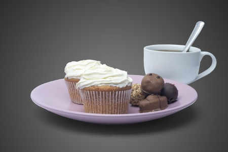cup of coffee, sweets and cake on the plate Stock Photo