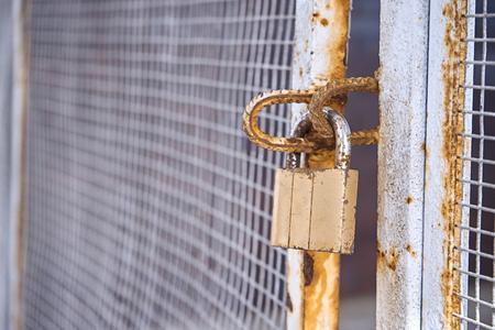 Locked gates with old rusty lock