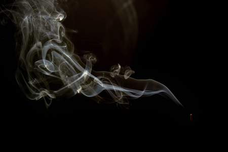 smoke or steam on a black background