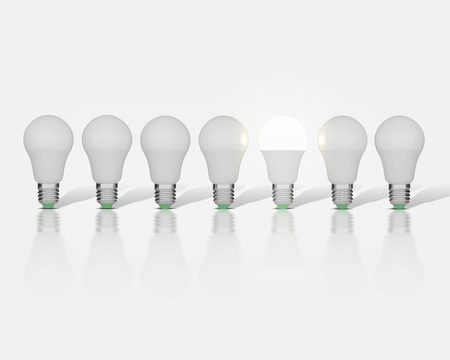 7 light bulbs on a white background, one had an idea 写真素材