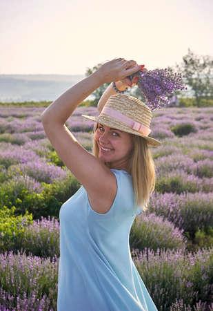 cute woman standing on a beautiful lavender field Banco de Imagens - 150641171