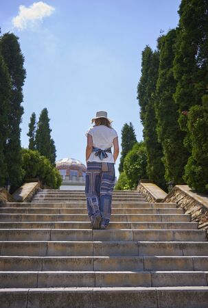Beautiful girl climbs the stairs in a beautiful manor Banco de Imagens