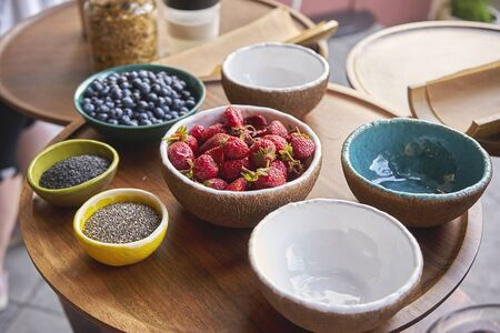 Ceramic plates with delicious fruit and healthy seeds Banco de Imagens - 132221560