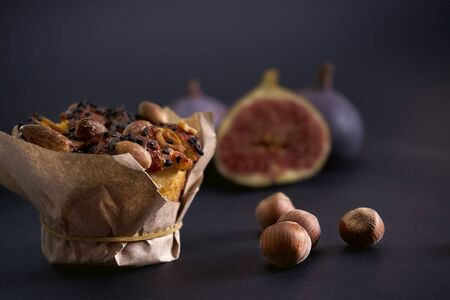 Delicious  diet curd cake lies on the table, next to hazel, and back cut figs