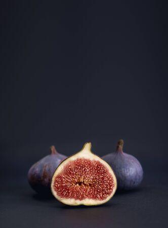Ripe figs on a dark