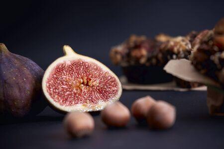 Ripe figs lies near diet muffins