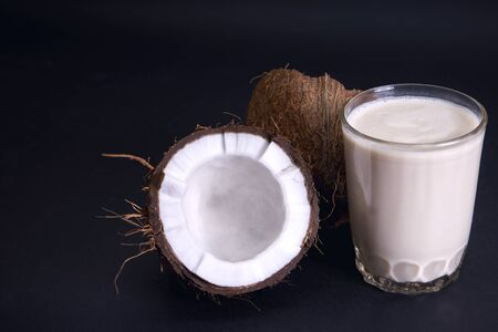 Coconut and coconut milk on a dark