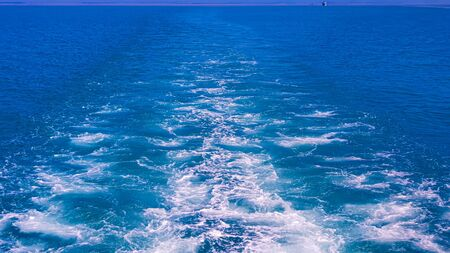 Ocean water and ocean waves view from the back of a ship in South Asia