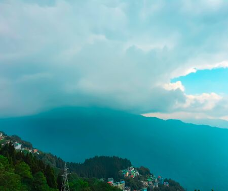Small town at the edge of the mountain in Gangtok,sikkim,north India with clouds flying over in the sky