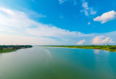 View of a river from the bridge with white clouds on the sky in Bangladesh. River Bangladesh