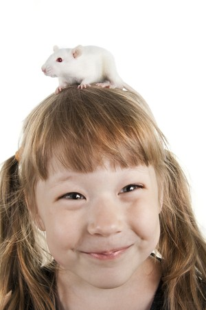 The cheerful girl with a rat on her head photo