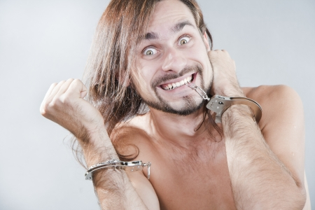 The guy has broken off his handcuffs Stock Photo - 15116267