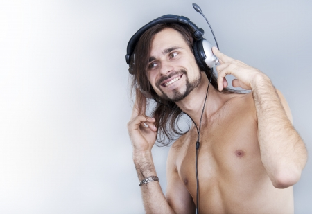young man in ear-phones listening the music Stock Photo - 15116254
