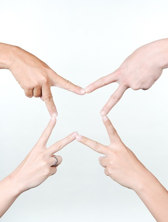 the star building by five people hand. symbol for show,we are friendly. all in one photo