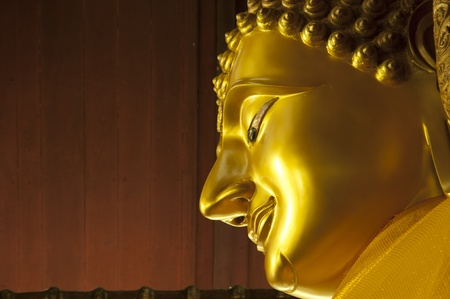 close up face of buddha statue in thailand temple photo