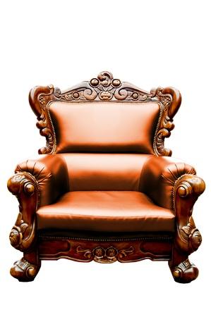 wood carving: vintage orange luxury leather armchair isolated