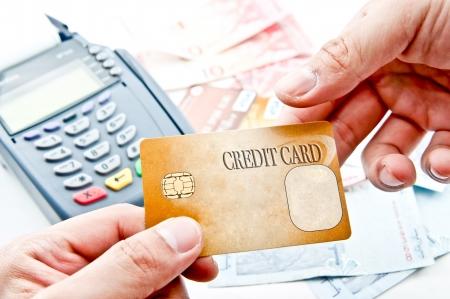 cr�dito: el pago de la m�quina y tarjeta de cr�dito Foto de archivo