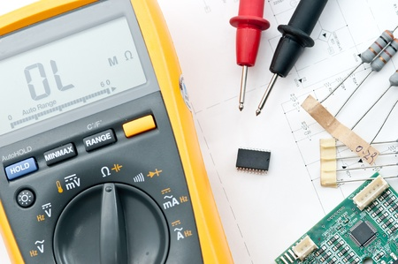 calibration: Checking Circuit by Multi-Meter. Electrical Engineer on during checking circuit board unit by Multi-Merer Stock Photo