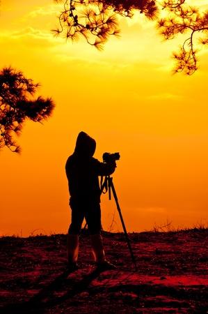 phukradueng: Photographer and Sunrise in Phukradueng national Park Thailand