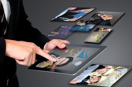 Businessman on touch pad photo