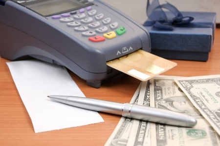 Close up Payment machine on during using Credit card from customer in shopping mall photo