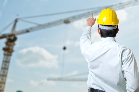 co operation: asia engineers with project  Stock Photo