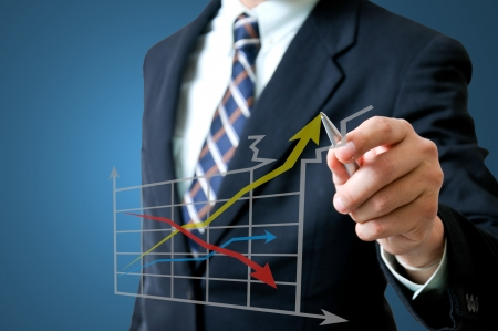 Business man with growing graph photo