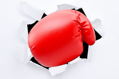 boxing sport: Punching though white paper Stock Photo