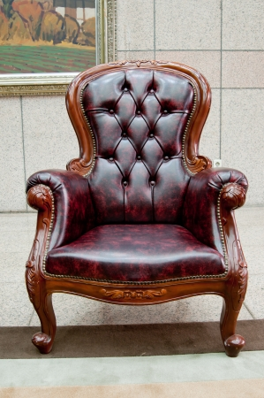vintage red luxury leather armchair isolated photo