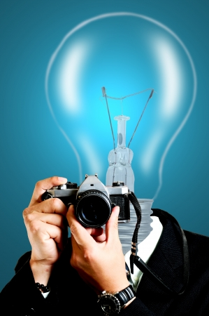 New paper photographer using SLR for capture photo Stock Photo - 14383958
