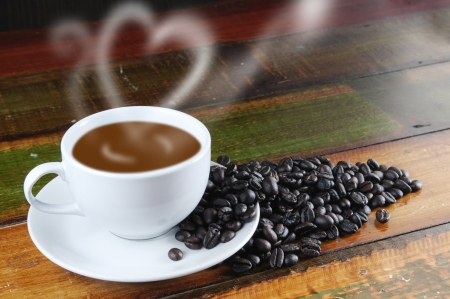 Coffee on the table with bean photo