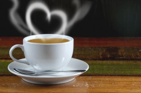 sweet heart: Smoke sweet heart coffee on the wood table