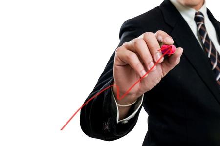 Businessman writing growing graph photo