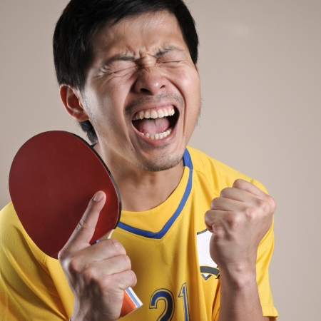 Table Tennis player very delight with his match point Stock Photo