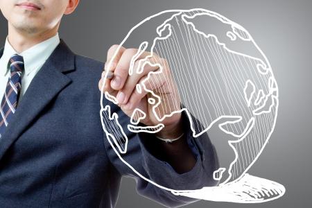 Businessman drawing  Global in studio Stock Photo - 17293006