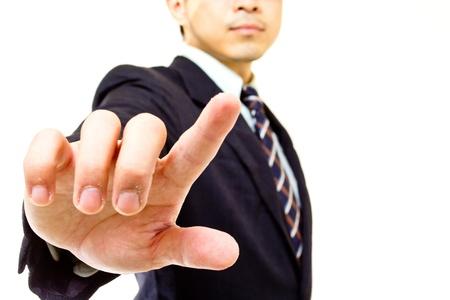 Businessman touching button in studio Stock Photo - 17341925