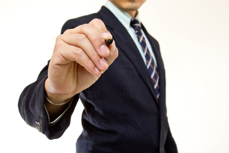 Businessman writing growing graph in studio Stock Photo