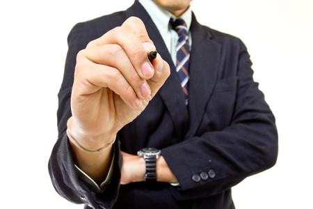 Businessman writing growing graph in studio photo