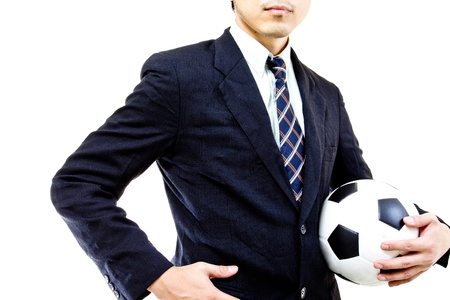 Football manager hold ball with his hands in studio photo