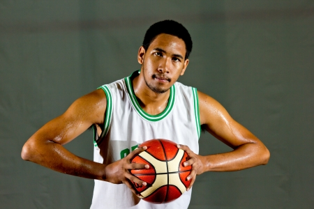 Basketball player prepare to shoot ball in the game photo