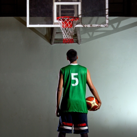Basketball player hold the ball for his game photo