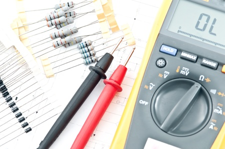 multimeter: Checking Circuit by Multimeter. Electrical Engineer on during checking circuit board unit by Multimeter Stock Photo