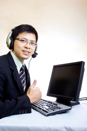 Asian man call center with phone headset with white background photo
