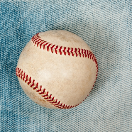 Baseball laying on green grass Stock Photo - 18902887