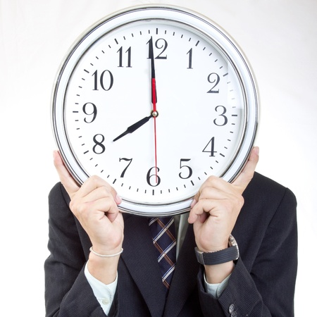show time: Businessman  holding clock  to show time to you Stock Photo