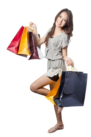 Asian woman with shopping bags in super market  photo