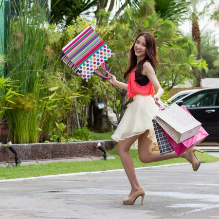 christmas shopping bag: Asian women on holding a lot of shopping bag in Super market