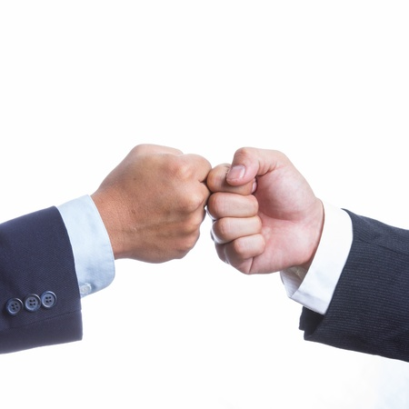 coordination: Two Businessman touching hand for coordination work Stock Photo