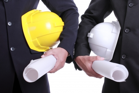 thier: Two Engineer people holding safety hat for work thier project with teamwork concept