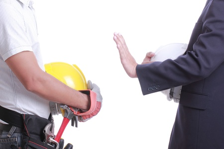 dissuade: Engineer show hand for give prohibit to worker with white background Stock Photo